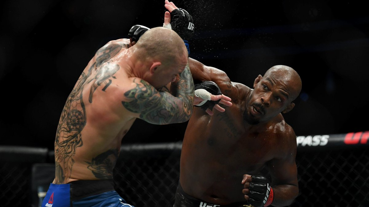 Jones punching Smith inside the cage at UFC 235